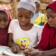 BBC-Image of girls sharing textbook-130M girls without education