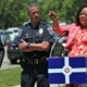 Director of Community Violence Reduction, Shonna Majors giving speech with chief of police and mayor of Bellamy Park, IN